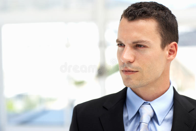 Young business man wearing suit in office stock photos