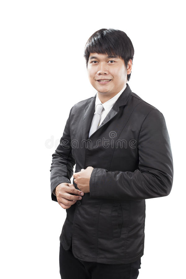 Young business man with western suit standing in front of white stock photos