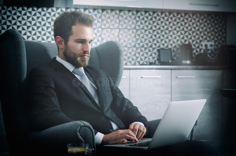 Young business man working from home with laptop. Home computer businessman laptop concept stock photo