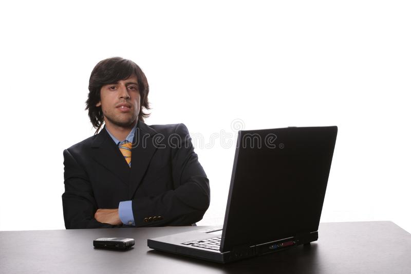 Young business man working on laptop royalty free stock images