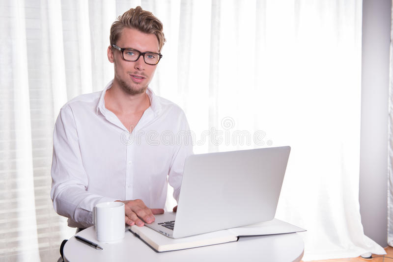 Young business man working on laptop royalty free stock photos