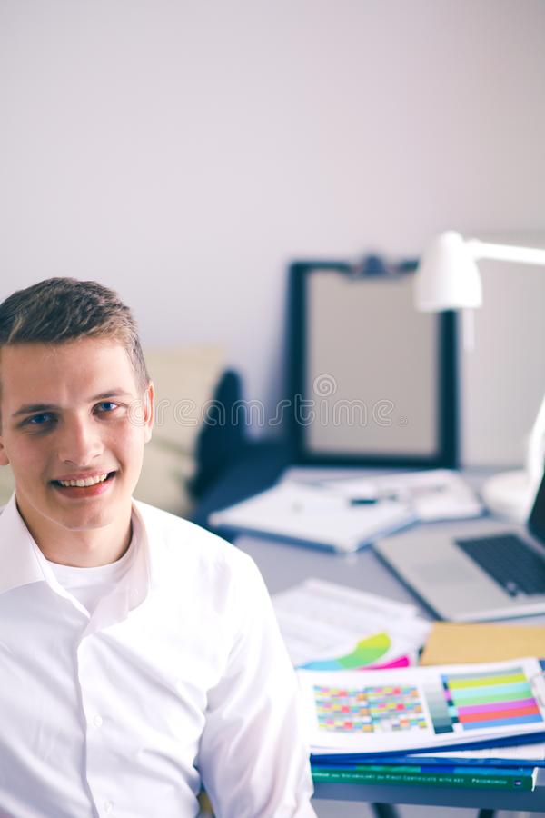 Young business man working in office ,standing . Young business man.  royalty free stock photo