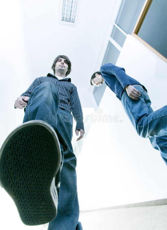 Young business men. Two young business men, students or employees walk on corridor royalty free stock photos