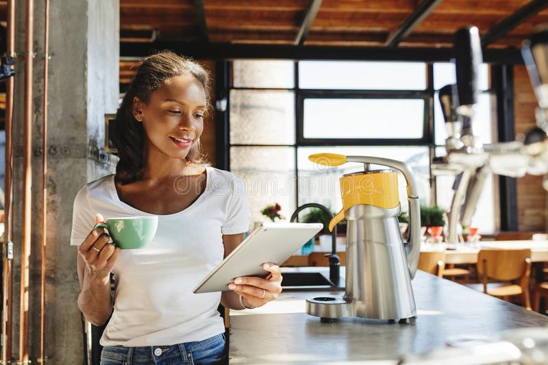 Young business owner standing at counter. stock image