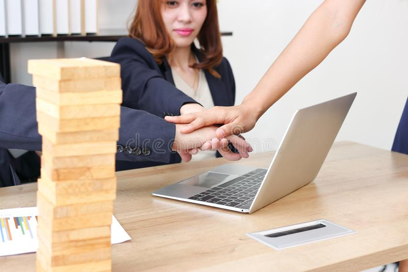 Young business partner joined hand together to greeting complete dealing in office. Success and teamwork concept.  royalty free stock photography