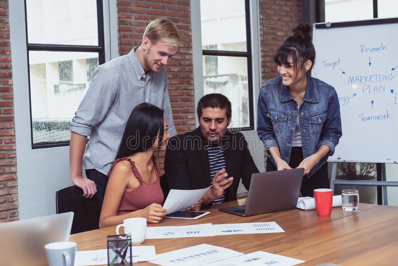 Young business partners discussing ideas or new project in modern office.Teamwork Concept royalty free stock photo