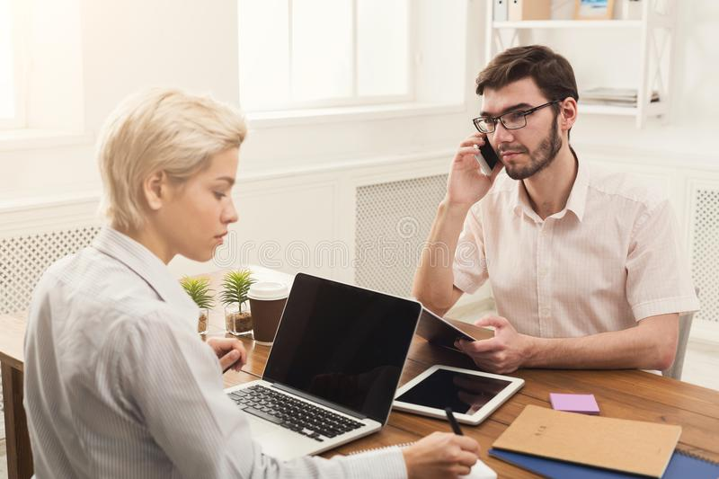 Young business partners working in office royalty free stock photo