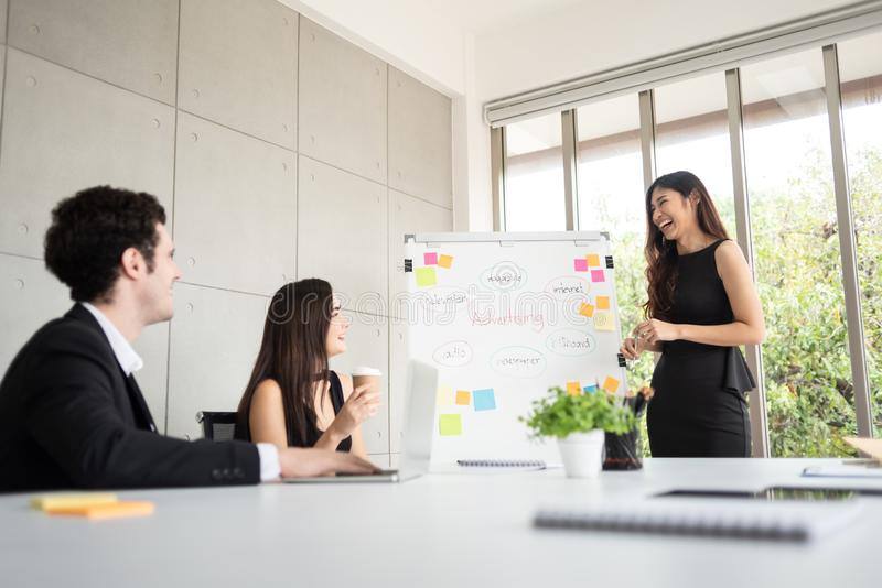 Young business people are brainstorming in boardroom meeting at royalty free stock photos