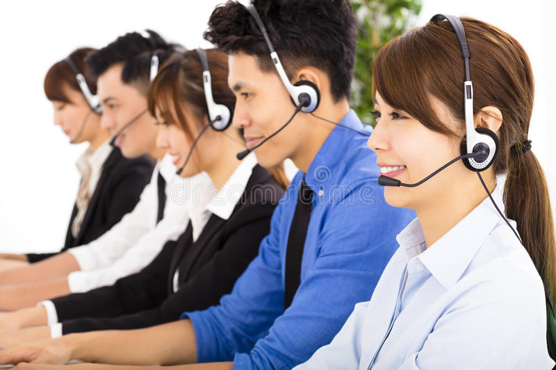 Young business people and colleagues working in call center. Young asian business people and colleagues working in call center stock photo