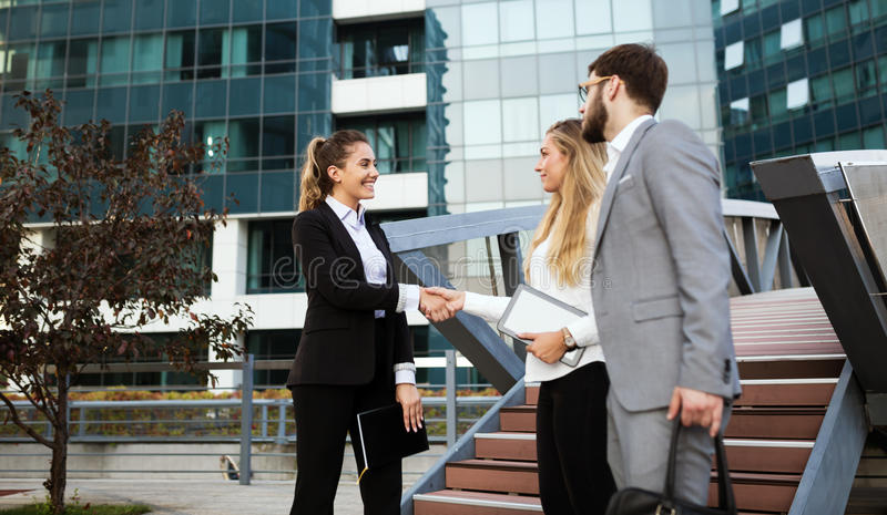 Young business people cooperating royalty free stock photo
