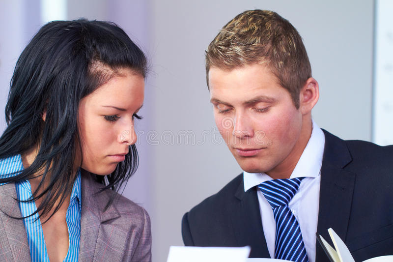 Young business people discuss something stock photo