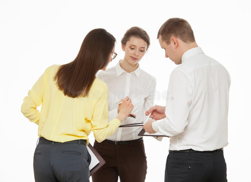 Young business people discussing new business idea. White background royalty free stock image