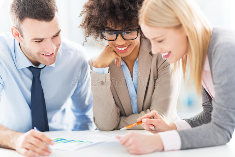 Young business people discussing in office royalty free stock photography