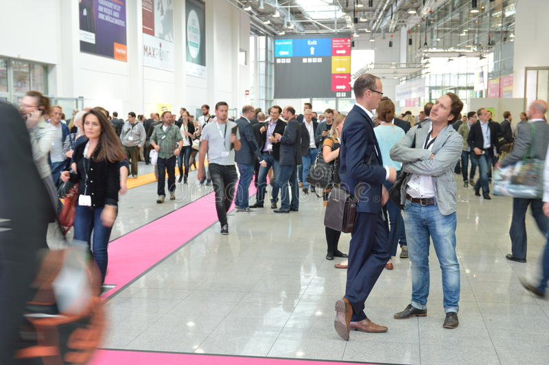 Young business people on german trade show royalty free stock photography
