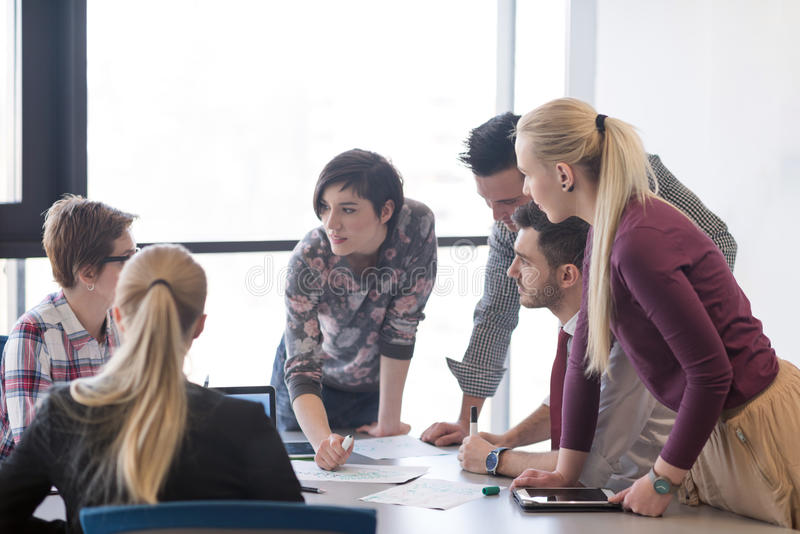 Young business people group on meeting at modern office royalty free stock photos