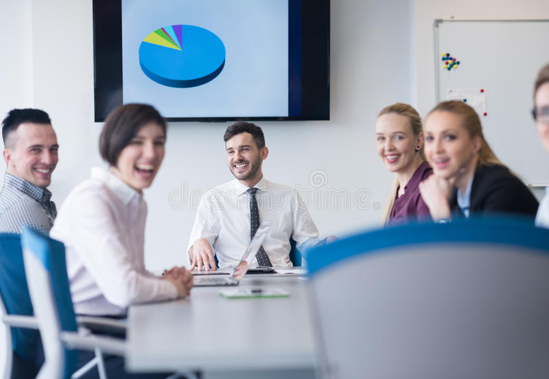 Young business people group on team meeting at modern office. Startup business, young creative people group brainstorming on team meeting at modern office royalty free stock photography