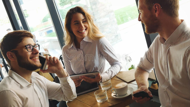 Young business people having a coffee break stock image