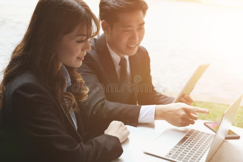 young business people having a meeting. businessman & businesswoman working with computer at cafe. startup man & freelance woman stock image
