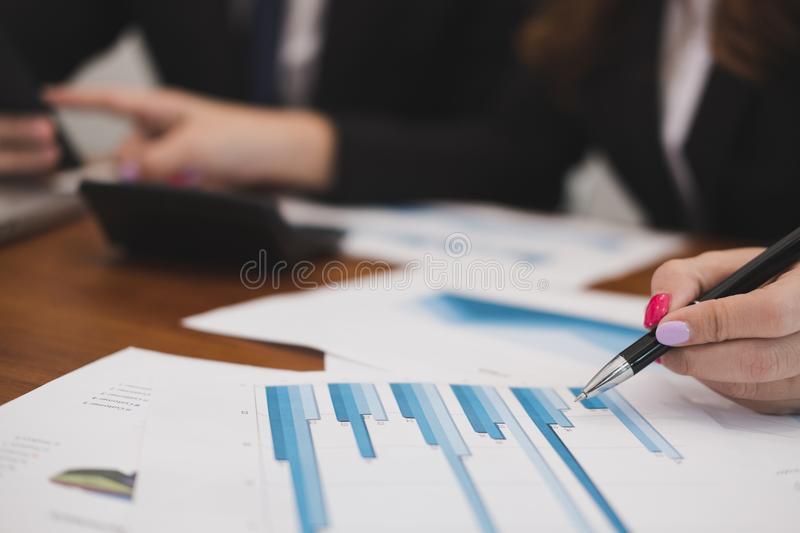 business people having a meeting. businessman & businesswoman working with financial chart report. startup man & freelance woman stock images