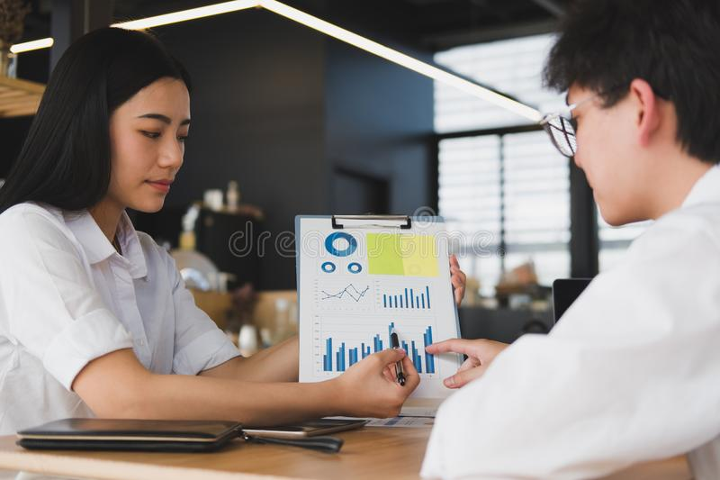 business people having a meeting in office. businessman & businesswoman working together at workplace. startup man & woman have royalty free stock image