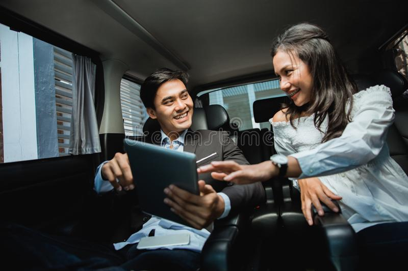 Young business people meeting in the car stock images