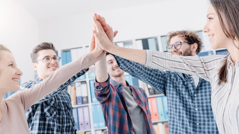 Young people joining hands together royalty free stock photo