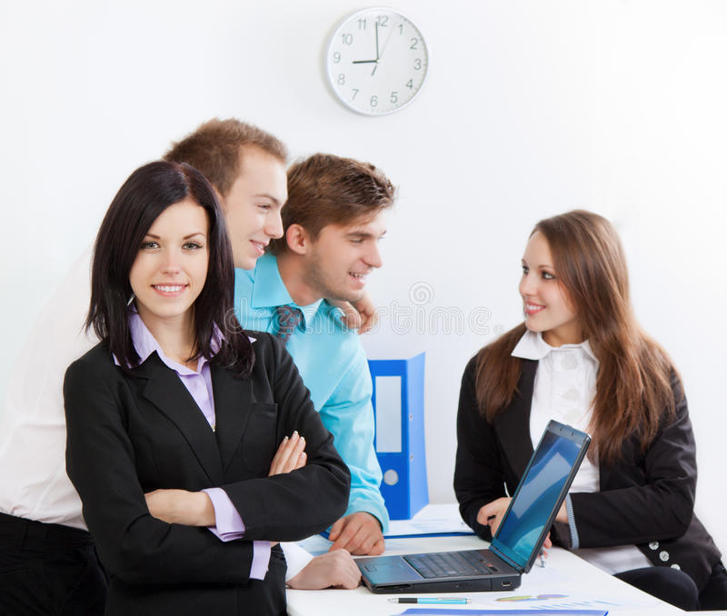 Young business people in office. At the desk royalty free stock image