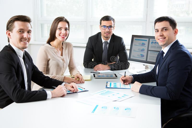 Young business people smiling looking at camera stock images