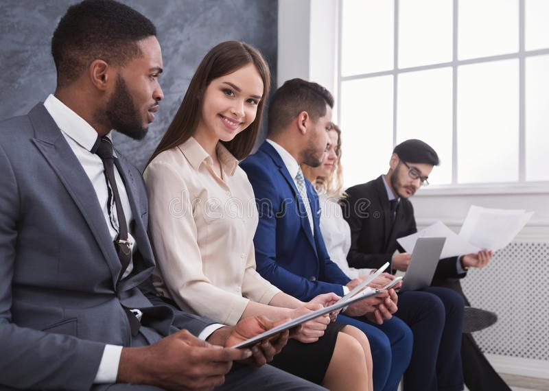Young business people preparing for job interview. Young business people waiting in queue before job interview royalty free stock photos