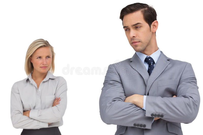 Young business people standing together showing rivalry stock image