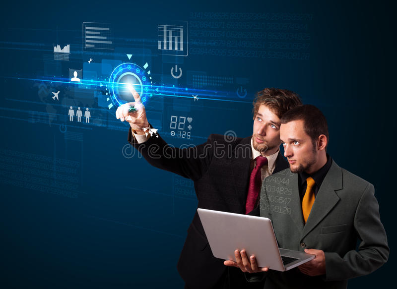 Young business people touching future web technology buttons and. Business couple touching future web technology buttons and icons stock photos