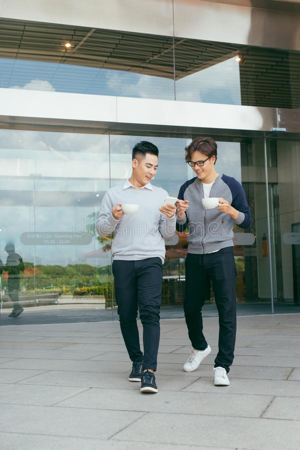 Young business people is walking and relax smile with city background royalty free stock images