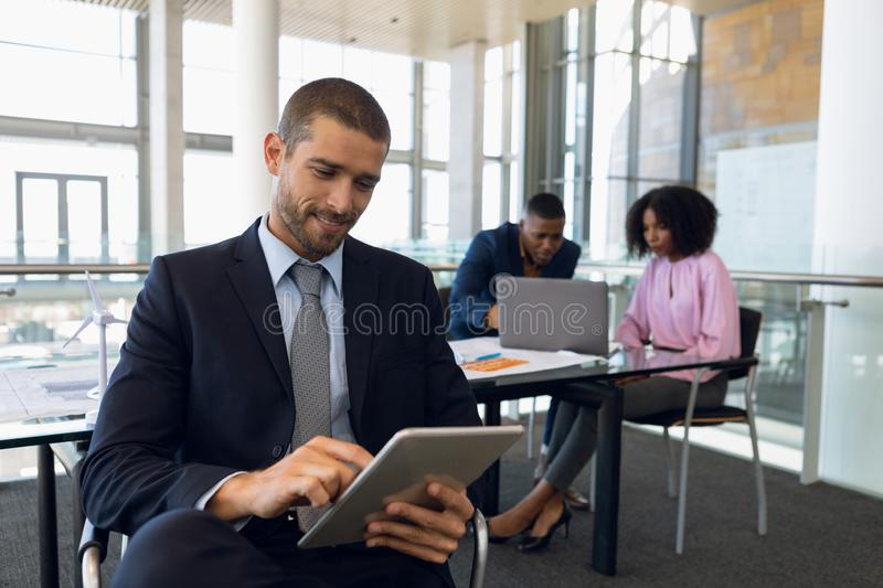 Young business people working in modern office stock images