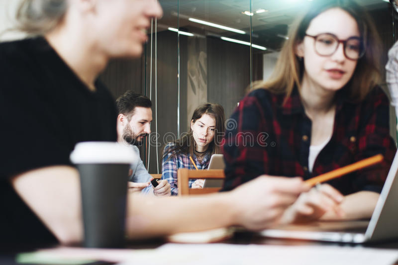 Young business people working at a new project in modern loft sp royalty free stock photography