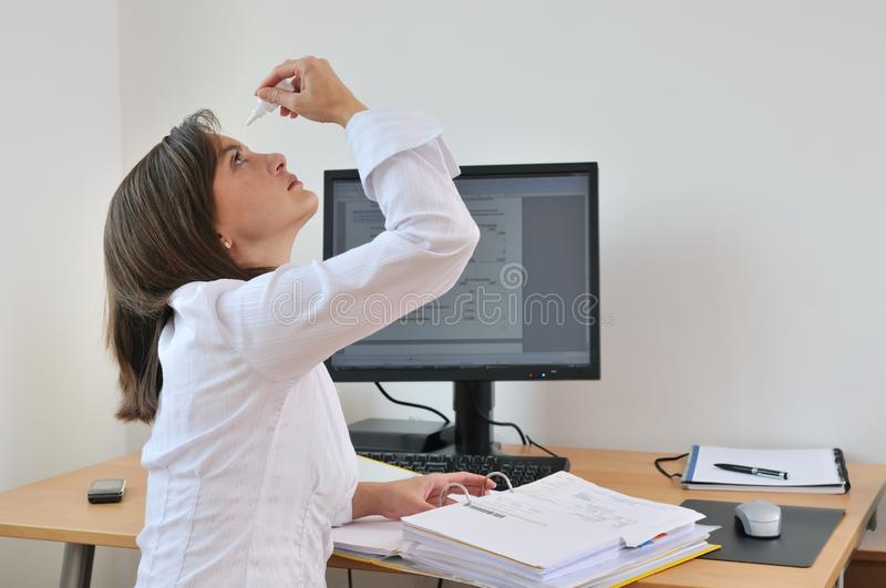 Download Young Business Person Applying Eyes Drops Stock Photo - Image: 21241526