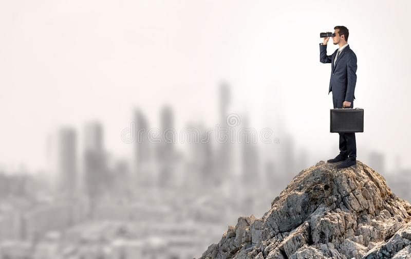 Business person looking to the city from distance royalty free stock image
