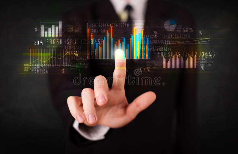 Young business person touching colorful charts and diagrams royalty free stock image