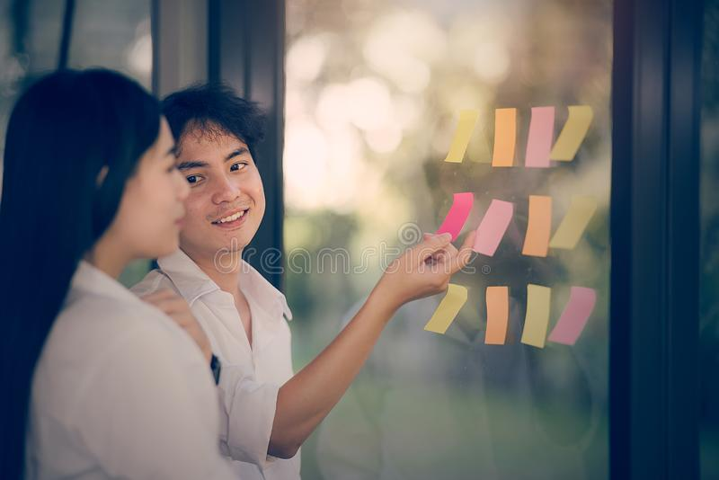 Young business persons are discussing with happiness stock image