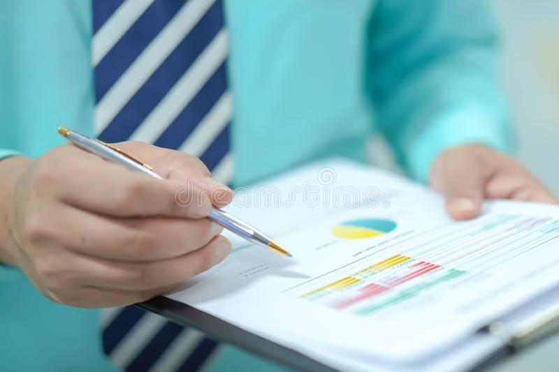 Young business smart manager working with new success startup project analyze graph plan. royalty free stock photography