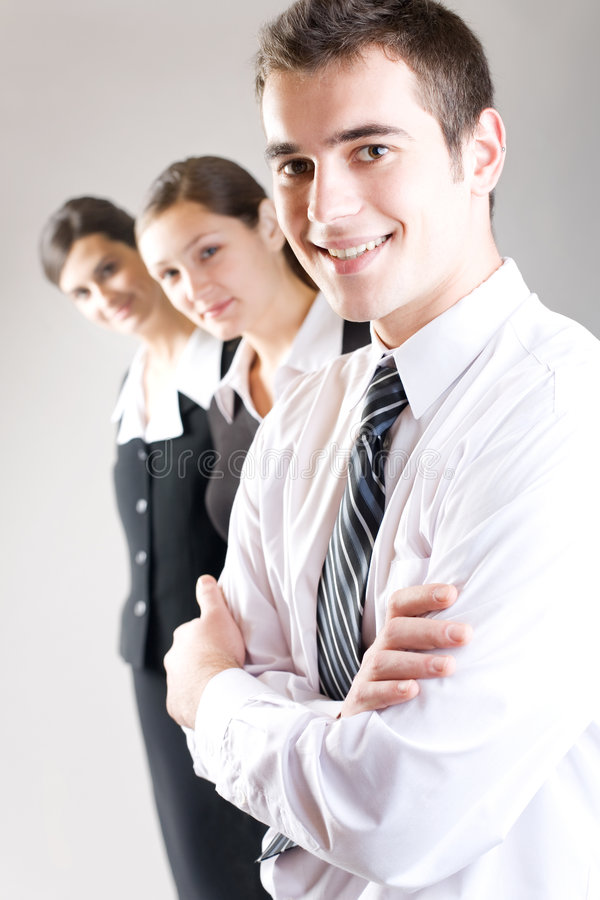 Young business team. Young businessman with two businesswomen
