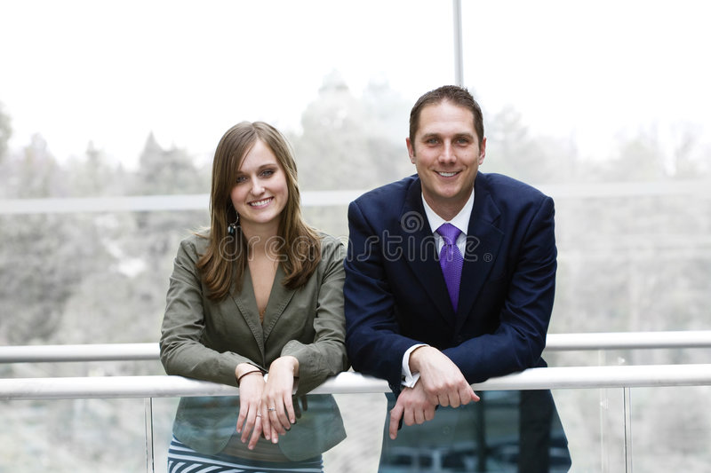 Young Business Team. A male/female business team smiling together. A successful business team stock image
