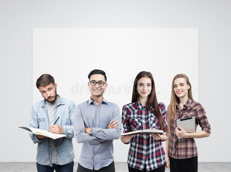 Young business team and blank poster royalty free stock photos
