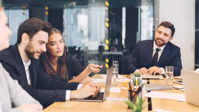 Young business team discussing new ideas in office royalty free stock image