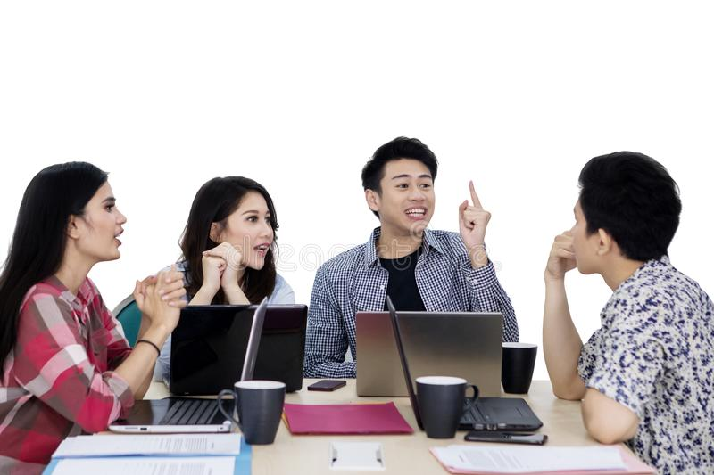 Young business team discussing new project on studio stock images