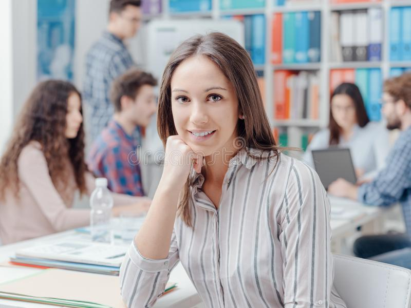 Young business team and girl smiling stock photo