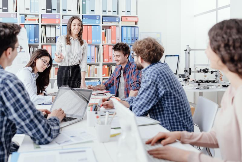 Young business team meeting in the office royalty free stock photography