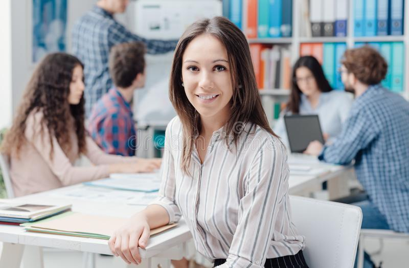 Young business team and girl smiling stock photos