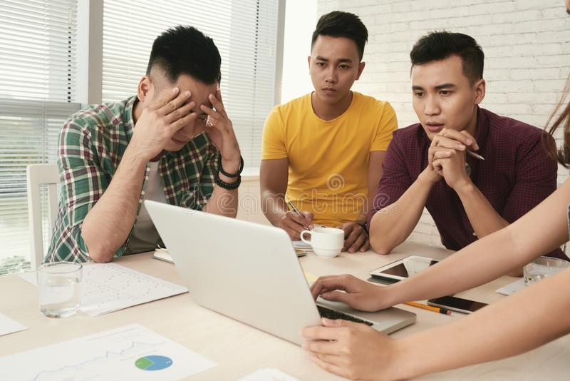 Bad news. Young business team reading bad news in e-mail royalty free stock photo