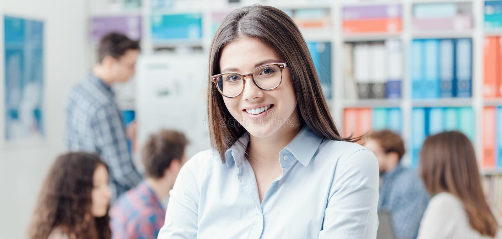 Young business team and smiling businesswoman stock photo