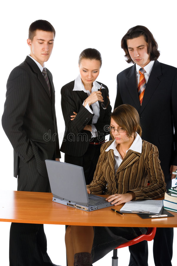 Young Business Team Solving A Problem Royalty Free Stock Photography
